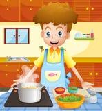 Eine Küche mit einem Mannkochen Stockbild