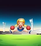 Eine kleine Cheerleader auf dem Gebiet Lizenzfreies Stockbild