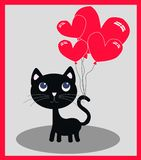 Eine kleine schwarze Katze mit Ballonen Stockbilder