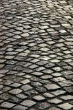 Eine Kopfsteinstraße Stockbild