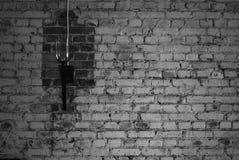 Eine Lampe auf einem brickwall lizenzfreies stockfoto