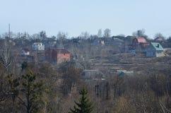 Eine Landlandschaft mit vielen ländlichen Häuschen Lizenzfreie Stockbilder