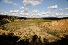 Eine Landschaft der Ebenen, der Felsen und der Wolken lizenzfreie stockfotos