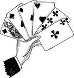 Eine männliche Hand mit den Spielkarten Lizenzfreies Stockbild