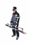 Eine männliche Skifahrervertretung, wie man volle Ausrüstung trägt Stockfotografie