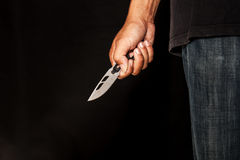 Eine Mörderperson mit Scharfem Stockbilder