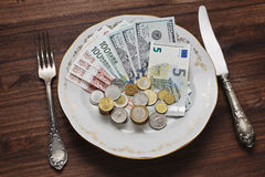 Eine Mahlzeit des Geldes Stockfotos