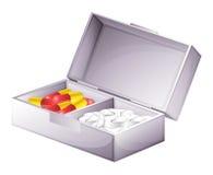 Eine Medizinausrüstung mit Kapseln und Tabletten stock abbildung
