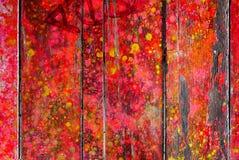 Eine mehrfarbige hölzerne Wand Lizenzfreie Stockfotos