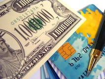Eine Million Dollar und Karten Stockbild