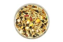 Eine Mischung von Körnern und von Getreide in einer Glasschale lizenzfreies stockbild