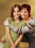 Eine Mutter mit ihrer Tochter Lizenzfreies Stockfoto