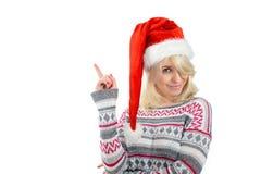 Eine nette Frau in Sankt Hut oben zeigend mit dem Finger Stockbilder
