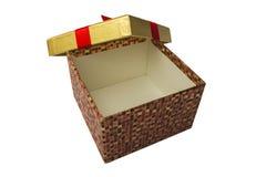 Eine offene Geschenkbox mit einem roten Band Getrennt Lizenzfreies Stockfoto