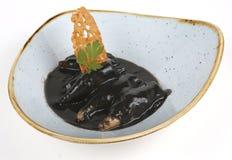 Eine Platte von Kopffüßern in der schwarzen Tinte Lizenzfreie Stockfotografie