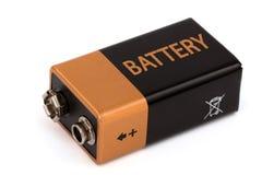Eine quadratische Batterie, lokalisiert auf weißem Hintergrund Stockbild