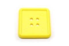 Eine quadratische gelbe Taste Stockbild