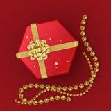 Eine realistische rote Geschenkbox verziert mit einem Goldbogen, Draufsicht Auch im corel abgehobenen Betrag Stockfotografie