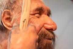 Eine realistische Wiedergabe eines prähistorischen alten Mannes Stockfoto