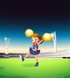 Eine recht junge Cheerleader am Feld Lizenzfreies Stockfoto