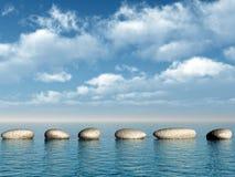 Eine Reihe der Steine im Wasser