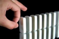 Eine Reihe von Dominos Stockfotografie