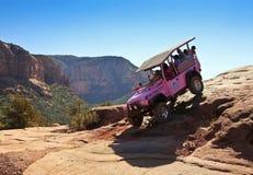 Eine rosa Jeep Tour Descends Broken Arrow-Spur Lizenzfreies Stockfoto