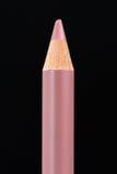 Lippenzwischenlagen-Bleistift auf schwarzem Hintergrund Lizenzfreies Stockbild