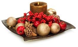 Eine Saisondekoration mit einer Kerze stockbild