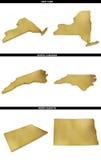 Eine Sammlung goldene Formen von den amerikanischen Staaten New York, North Carolina, North Dakota US Lizenzfreies Stockbild