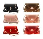 Eine Sammlung kleine Theaterhandtaschen und -geldbeutel in den verschiedenen Farben Lizenzfreies Stockfoto