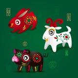 Chinesische Tierkreis-Maskottchen: Kaninchen, RAM und Schwein Stockfotos