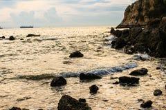 Eine schöne digitale Manipulationslandschaft des Sonnenuntergangstrandes Selecti stockfoto