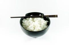 Eine Schüssel Reis über weißem Hintergrund Stockfotografie