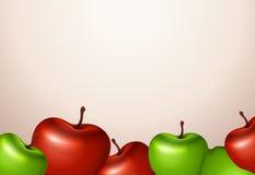 Eine Schablone mit den roten und grünen Äpfeln Stockbilder