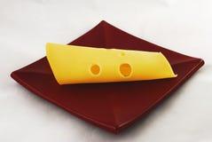 Eine Scheibe des Käses Stockfoto