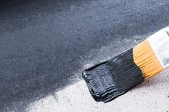 Eine Schicht schwarze Farbe auf der Oberfläche Stockfotos