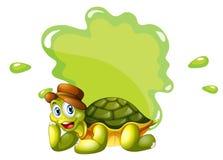Eine Schildkröte an der Unterseite einer leeren Schablone Lizenzfreie Stockfotos