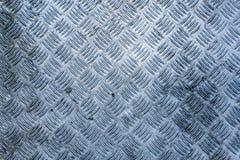 Eine schmutzige, abgenutzte und verwitterte Diamantplatte lizenzfreies stockbild