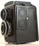 Eine sehr alte Kamera, die mit weißem Hintergrund lokalisiert worden ist lizenzfreie stockfotos