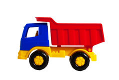 Eine Seitenansicht des hellen Plastikspielzeuglastwagens Lizenzfreie Stockbilder