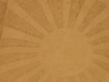 Eine Sonne mit Sonnenstrahlen im Sand Lizenzfreies Stockfoto