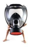 Eine Spielzeugabbildung in einer Gasmaske Stockfotos