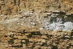 Eine Steinwand mit Schatten für Hintergrund, Design Lizenzfreies Stockfoto