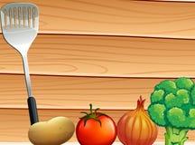 Eine Tabelle mit einem laddle und Gemüse Lizenzfreie Stockfotografie