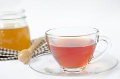 Eine Tasse Tee mit Honig Stockbild