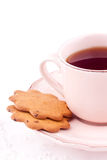 Eine Tasse Tee und Keks Stockbild