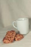 Eine Tasse Tee und Plätzchen Lizenzfreie Stockfotografie