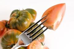 Eine Tomate in einer Gabel Stockbild
