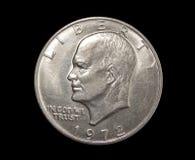 Eine US-Dollar Münze auf lokalisiertem schwarzem Hintergrund Lizenzfreies Stockbild
